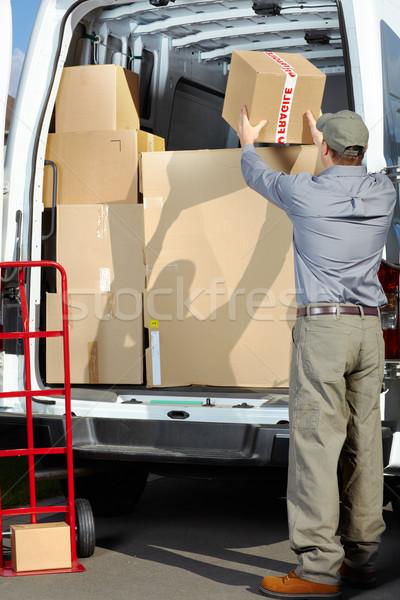 Entrega serviço postal homem feliz profissional expedição Foto stock © Kurhan
