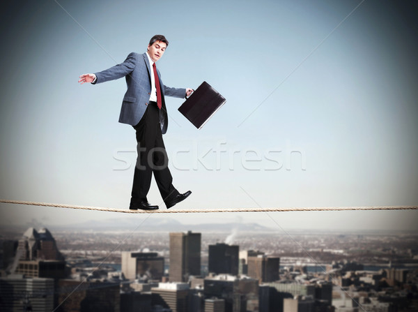 Stock photo: Businessman walking on rope.