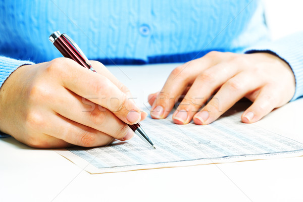 Business woman filling document. Stock photo © Kurhan