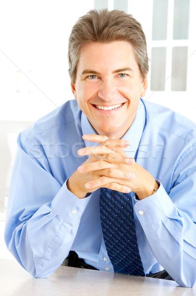 ビジネスマン 笑みを浮かべて ホーム 背景 キッチン 作業 ストックフォト © Kurhan