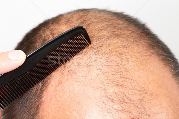 Man head with a comb. Stock photo © Kurhan