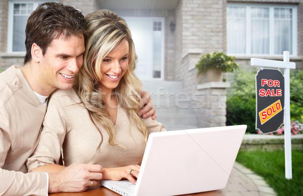 Couple with laptop near new house. Stock photo © Kurhan