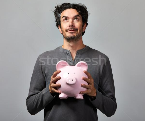 Stockfoto: Jonge · man · spaarvarken · knap · glimlachend · toevallig · man