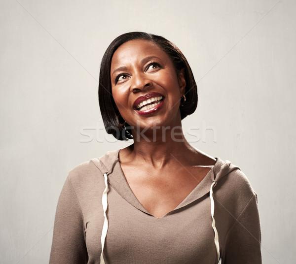 Gondolkodik mosolyog afrikai nő afroamerikai megoldás Stock fotó © Kurhan