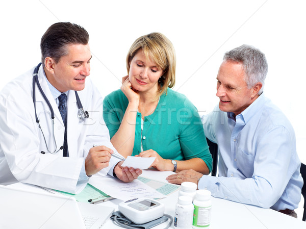 Senior couple and a doctor. Stock photo © Kurhan