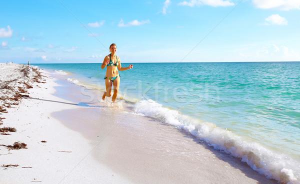 Feliz mulher Miami praia corrida férias Foto stock © Kurhan