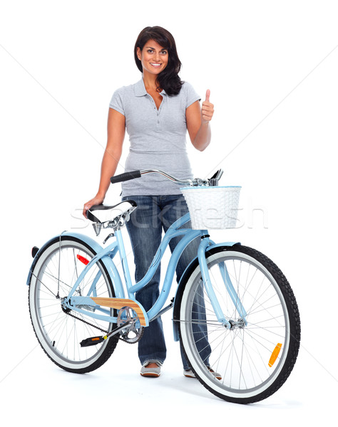 Stock photo: Young asian woman with bicycle.
