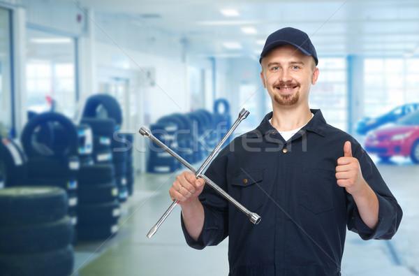 笑みを浮かべて タイヤ レンチ 自動車修理 サービス ストックフォト © Kurhan