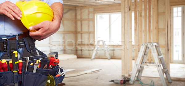 Builder handyman with construction tools. Stock photo © Kurhan
