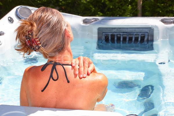 Mooie vrouw ontspannen hot tub jonge water gezondheid Stockfoto © Kurhan