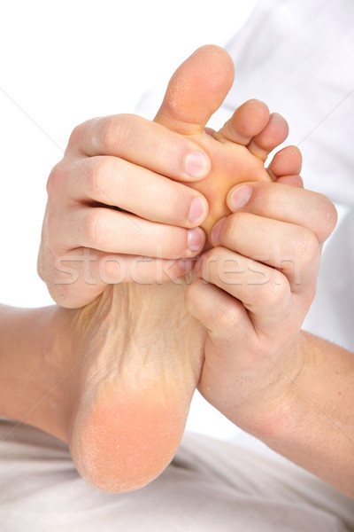 Homme pieds massage blanche fille main Photo stock © Kurhan