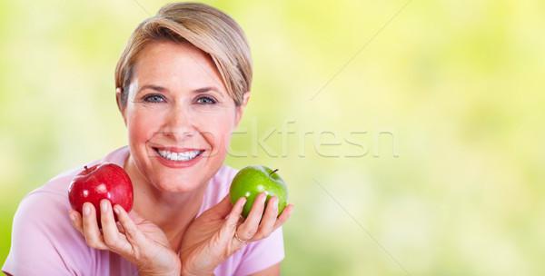 Mature smiling woman with apple. Stock photo © Kurhan
