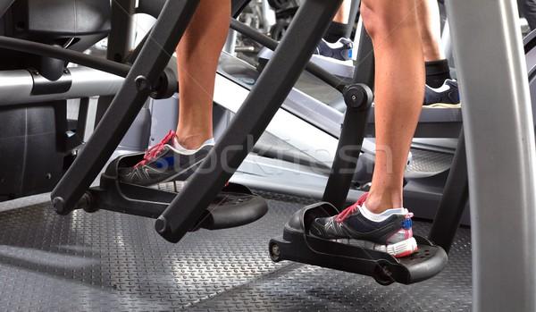 Legs on elliptical trainer Stock photo © Kurhan