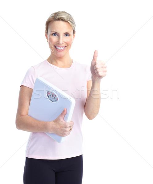 woman with a bathroom scale Stock photo © Kurhan