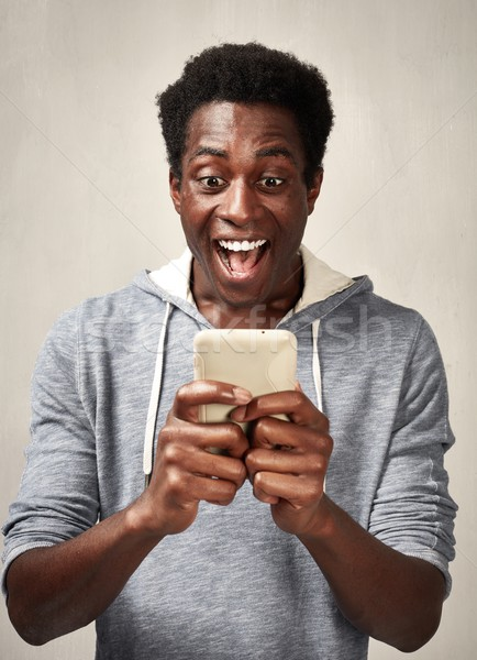 Black man with smartphone Stock photo © Kurhan