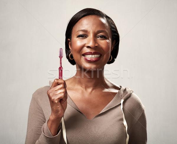 Black woman with toothbrush Stock photo © Kurhan