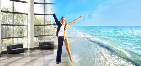 Happy business woman on the beach. Stock photo © Kurhan
