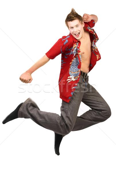 счастливым чувак смеясь прыжки изолированный белый Сток-фото © Kurhan