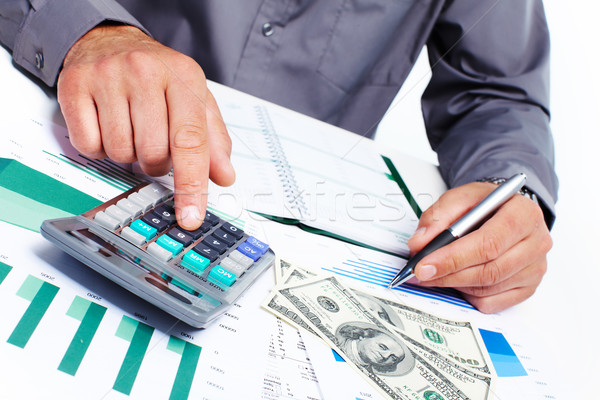 Hands of accountant businessman with calculator Stock photo © Kurhan