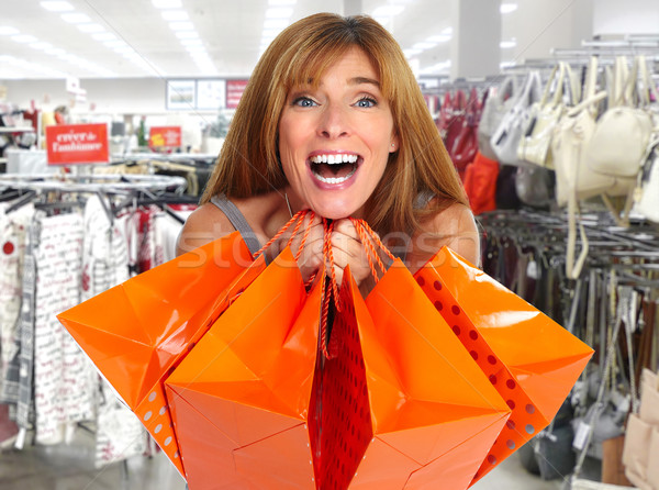 Shopping woman with  gifts. Stock photo © Kurhan