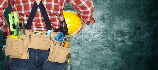 Builder with construction tools. Stock photo © Kurhan