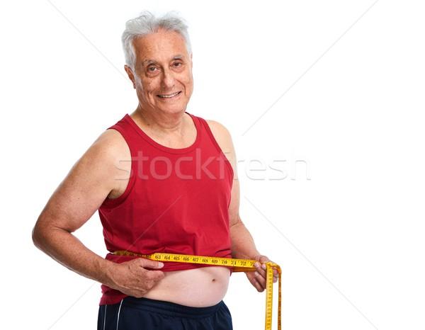 Hombre cinta métrica altos ancianos abdomen Foto stock © Kurhan