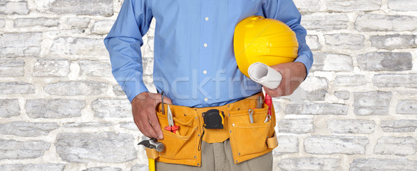 Construction worker with helmet and tool belt. Stock photo © Kurhan