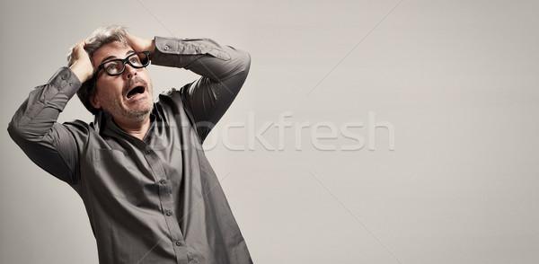 Ijedt félő férfi félelem portré szürke Stock fotó © Kurhan