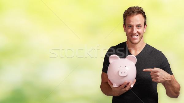 Stockfoto: Glimlachend · man · spaarvarken · knap · toevallig · roze
