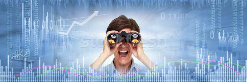 Investor woman with binoculars Stock photo © Kurhan