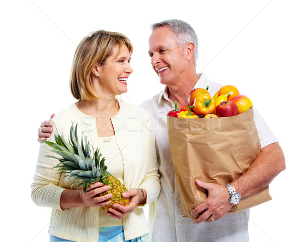 Senior couple with a grocery shopping bag. Stock photo © Kurhan