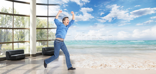 Man running on the beach. Stock photo © Kurhan