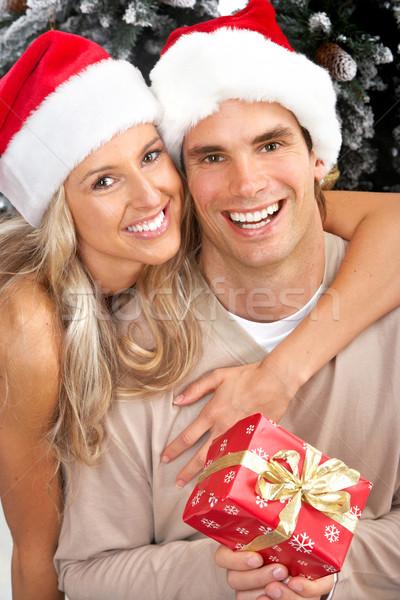 Stockfoto: Christmas · paar · jonge · gelukkig · kerstboom · geïsoleerd