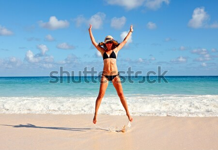 Happy woman on the beach. Stock photo © Kurhan