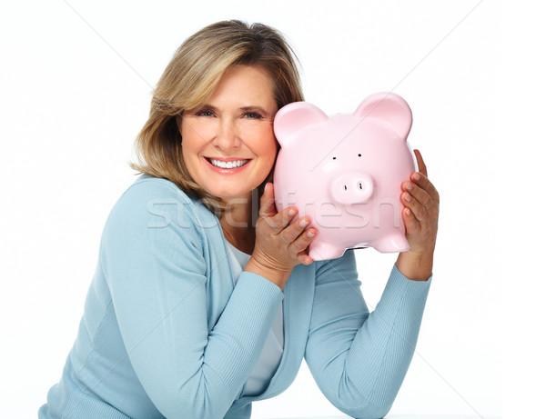 Senior woman with a piggy bank. Stock photo © Kurhan