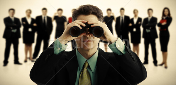 Stock photo: Businessman with binoculars.
