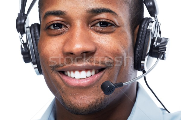 Stock photo: Man with headphones. Call center operator