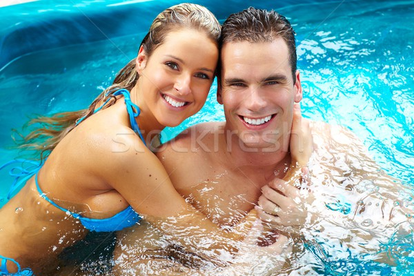 Young couple relaxing in jacuzzi. Stock photo © Kurhan
