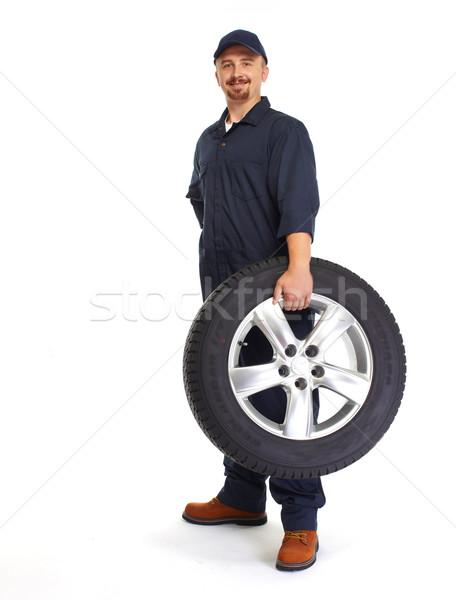 Car mechanic with a tire. Stock photo © Kurhan