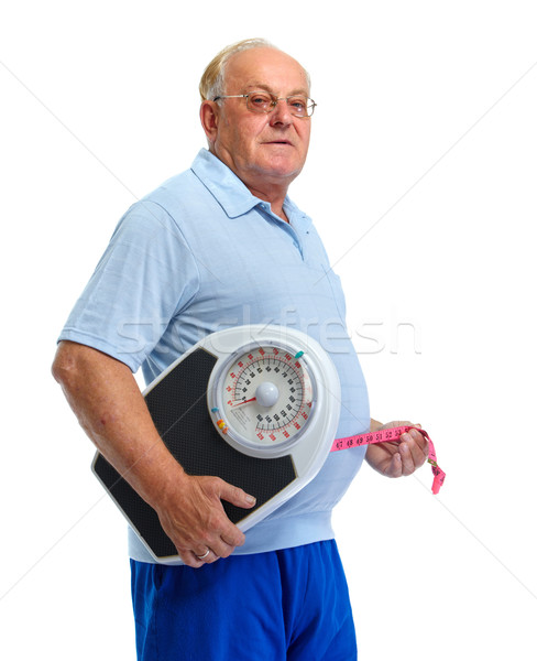 Senior man with scales and measuring tape. Stock photo © Kurhan