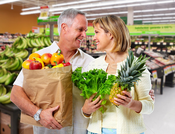 Senior couple with grocery bag of vegetables. Stock photo © Kurhan