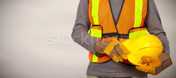 Trabalhador capacete laranja segurança colete Foto stock © Kurhan
