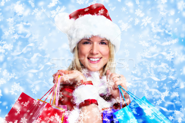 Santa girl with shopping bags. Stock photo © Kurhan