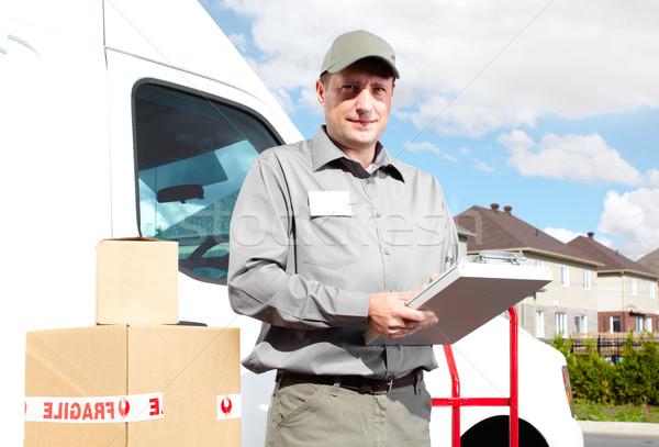 Consegna servizio postale uomo felice professionali spedizione Foto d'archivio © Kurhan