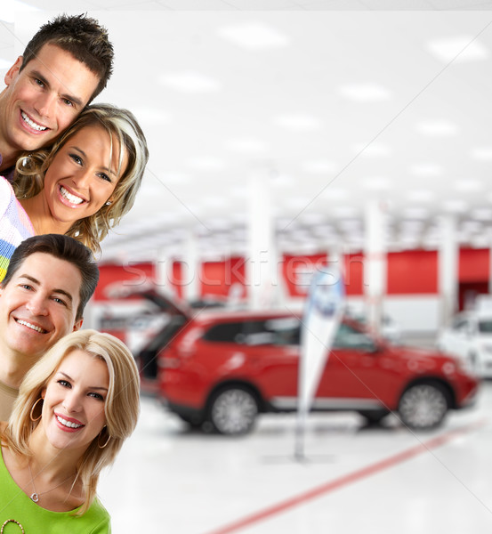 Stock photo: Happy people near new car.
