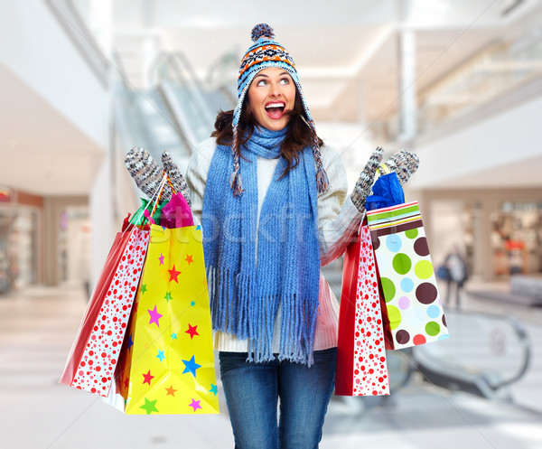 Beautiful shopping Christmas woman with bags. Stock photo © Kurhan