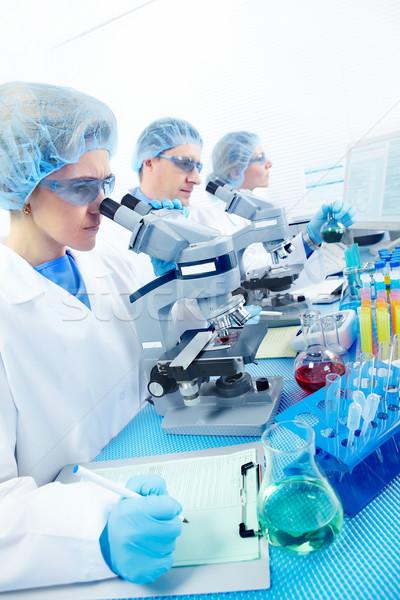 Foto stock: Laboratório · ciência · equipe · trabalhando · mulher · homem