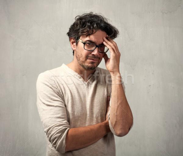 Baş ağrısı bunalımlı adam gri duvar yüz Stok fotoğraf © Kurhan