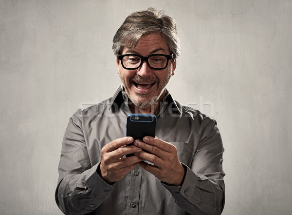 Stock photo: Man with cellphone