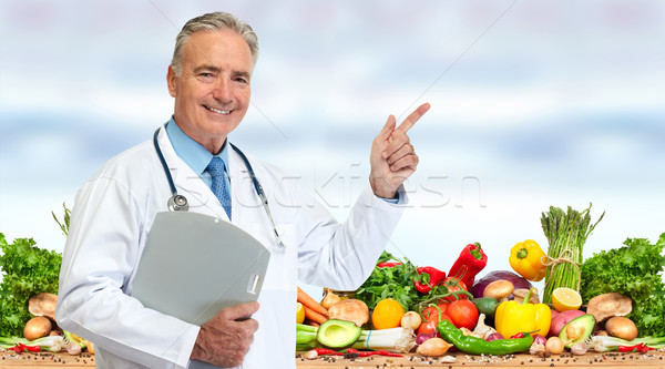 Doctor nutritionist with vegetables food Stock photo © Kurhan
